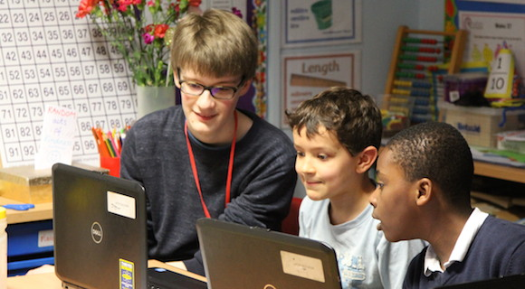STIMULUS student volunteer with primary school pupils